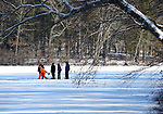 Playing in the pristine setting, The Hartford Saengerbund, a German-American culture organization,  play Eisstockschiessen or Bavarian Curling, Thursday, January 18, 2018,  at Walkers Reservoir in Vernon. Six-members of about 20 who play from the Newington based club braced the cold and wind, on what was agreed to be some of the best ice conditions in several years.  The group brings treats and hot coffee and will spend several hours each visit playing from late morning almost to dusk. The group has been doing this here dating back to 70's, and now just like than,  playing for 25 cents a game. (Jim Michaud / Journal Inquirer)