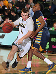 SPEARFISH, SD - FEBRUARY 6, 2016 -- Wyatt Krogman #11 of Black Hills State drives past Joshua Blaylock #1 of Ft. Lewis College during their college basketball game Saturday at the Donald E. Young Center in Spearfish, S.D.  (Photo by Dick Carlson/Inertia)