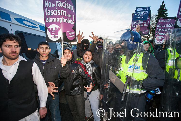 © Joel Goodman - 07973 332324 . 11/12/2010 . Peterborough , UK . Police in riot gear lead counter-protesters through the town . The English Defence League ( EDL ) hold a demonstration in Peterborough . Photo credit : Joel Goodman