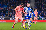 Lionel Messi of FC Barcelona (L) in action against Sergi Darder of RCD Espanyol (R) during the La Liga 2018-19 match between RDC Espanyol and FC Barcelona at Camp Nou on 08 December 2018 in Barcelona, Spain. Photo by Vicens Gimenez / Power Sport Images