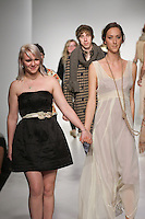 Senior fashion designer Maureen Flint, walks runway with model, at the close of the Pratt 2011 fashion show.