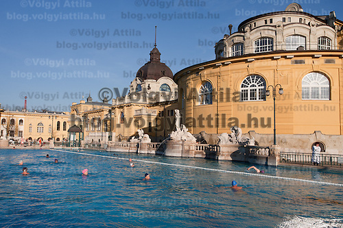 Visitors enjoy their time in the pool of Bath Szechenyi one of Hungary's traditional baths in Budapest, Hungary on March 24, 2011. ATTILA VOLGYI