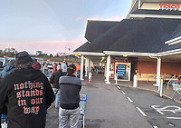 Shoppers queue just after dawn at this Tesco superstore in Kettering, Northants. Shelves are already empty and signs are up asking shoppers to be polite to staff and to address 'social distancing'. Kettering, UK Saturday March 21st 2020<br /> CAP/PP/SW<br /> ©Stuart Hogben/PP/Capital Pictures