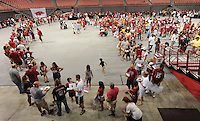 NWA Media/ANDY SHUPE - A long line of University of Arkansas fans waiting to secure autographs from the team's running backs waits during the annual  University of Arkansas Fan Day Sunday, Aug. 17, 2014, at Bud Walton Arena in Fayetteville. The day featured opportunities to have items autographed by members of the Razorbacks volleyball, soccer, football teams, mascots and the spirit squads. Visit photos.nwaonline.com to see more photos from the event.