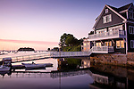 Sunrise reflected in the windows of a waterfront home, Camden, ME, USA