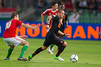 Hungary's Zoltan Gera (L) and Netherlands' Wesley Sneijder (R) fight for the ball during a World Cup 2014 qualifying soccer match Hungary playing against Netherlands in Budapest, Hungary on September 11, 2012. ATTILA VOLGYI