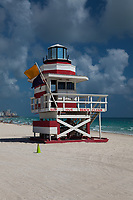 Colorful Red & White Painted Wood Lifeguard Tower, White Sand Tropical Beaches, South Beach, Miami, Florida, FL, America, USA.