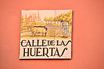 Antique street sign for Calle de las Huertas, painted tiles in Madrid, Spain
