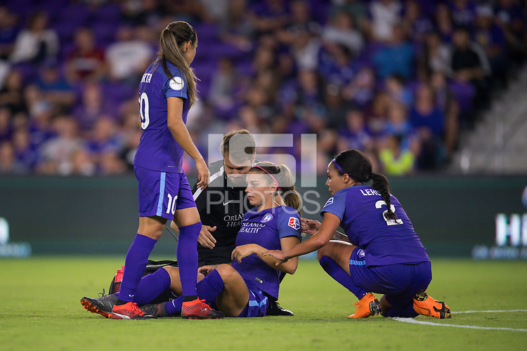 Orlando, FL - Saturday March 24, 2018: Orlando Pride forward Alex Morgan (13) is assisted by the training staff and Orlando Pride forward Sydney Leroux (2) after a collision during a regular season National Women's Soccer League (NWSL) match between the Orlando Pride and the Utah Royals FC at Orlando City Stadium. The game ended in a 1-1 draw.