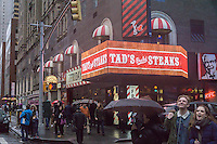 Advertising for Tad's Broiled Steaks in a storefront in New York containing an assortment of fast food and fast casual restaurants franchised by Reise Restaurants on Sunday, December 18, 2016. (© Richard B. Levine)