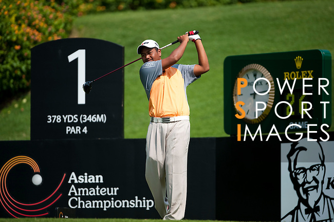 SHENZHEN, CHINA - NOVEMBER 01:  Mohd Iszaimi Ismail of Malaysia tees off on the 1st hole during the final round of the Asian Amateur Championship at the Mission Hills Golf Club on November 1, 2009 in Shenzhen, Guangdong, China.  (Photo by Victor Fraile/The Power of Sport Images) *** Local Caption *** Mohd Iszaimi Ismail