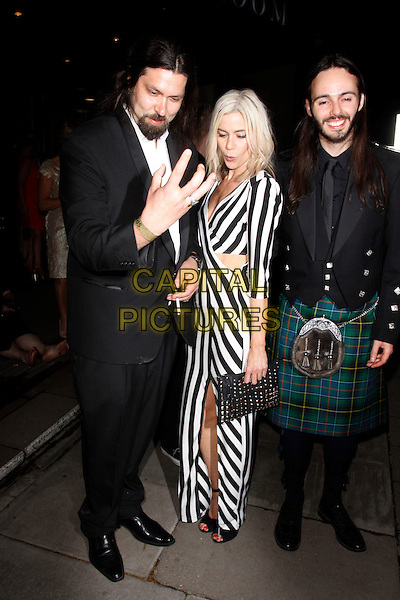 Kate Lawler & guests.Sony Radio Awards, Grosvenor House, London, England. .13th May, 2013.full length back white stripe dress slit split low cut plunging neckline cut out away suit green kilt beard facial hair hand funny looking down.CAP/AH.©Adam Houghton/Capital Pictures.
