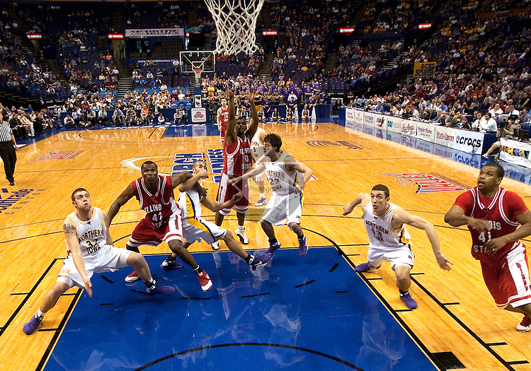 March 08 2009   Players from Illinois State (red) and Northern Iowa (white) watch a shot by Illinois State's Osiris Eldridge (0, at top of key in center) in the waning moments of the game.  The Panthers of the University of Northern Iowa defeated the Redbirds of Illinois State University 60-57 in overtime in the championship game of the Missouri Valley Conference Tournament on Sunday March 8, 2009 at the Scottrade Center in downtown St. Louis, Missouri.   ..         *******EDITORIAL USE ONLY*******