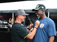 Apr 26, 2015; Baytown, TX, USA; A fan gets an autograph on his t-shirt by NHRA top fuel driver Steve Torrence during the Spring Nationals at Royal Purple Raceway. Mandatory Credit: Mark J. Rebilas-