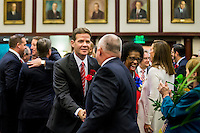 TALLAHASSEE, FLA. 1/12/16-Senate President Andy Gardiner, R-Orlando, center, shakes hands with Rep. Matt Hudson, R-Naples, as Sen. Arthenia Joyner, D-Tampa, second from right, greets a house member prior to the State of the State address during the opening day of the 2016 legislative session at the Capitol in Tallahassee.<br /> <br /> COLIN HACKLEY PHOTO