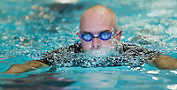 28 SEP 2014 - STOWMARKET, GBR - A competitor swims the 300m of the pool for the 2014 West Suffolk Triathlon in Stowmarket in Suffolk, Great Britain (PHOTO COPYRIGHT © 2014 NIGEL FARROW, ALL RIGHTS RESERVED)
