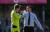 Derek Adams manager of Plymouth Argyle celebrates victory on the final whistle with Goalkeeper Luke McCormick of Plymouth Argyle during the Sky Bet League 2 match between Wycombe Wanderers and Plymouth Argyle at Adams Park, High Wycombe, England on 12 September 2015. Photo by Andy Rowland.