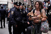NEW YORK, NY - APRIL 20: A Member of Occupy Wall Street carries his dog as he takes part during a spring training protest on April 20, 2012 in New York City
