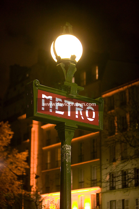 View of Metro sign above an entrance to a subway station in Paris, France on the eve of widespread strikes called by public workers in several sectors of the economy to protest against the planned reform of their favored retirement plans, 13 November 2007.