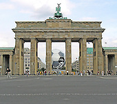 "Berlin, Germany - August 26, 2003 -- The street in front of the Brandenberg Gate in the former West Berlin, Germany looking towards the former East Berlin on August 26, 2003.  The gate was the background to many iconic photos an events including United States President John F. Kennedy's ""I am a Berliner"" speech in 1963 and United States President Ronald Reagan's call to President Mikhail Gorbachev of the Union of Soviet Socialist Republics (USSR) to ""tear down this wall"" in 1987.  The bricks in the street crossing the lower part of the photo is where the Berlin Wall stood from 1961 to 1989..Credit: Ron Sachs / CNP"