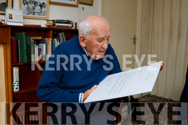 jack mckenna reading the presidents letter on friday last as he celebrates his 100th birthday