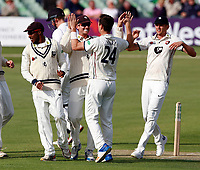 Matt Henry of Kent is mobbed after taking the wicket of Luke Wells during the Specsavers County Championship Div 2 game between Kent and Sussex at the St Lawrence Ground, Canterbury, on May 11, 2018