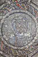 Winter, medallion from the Roman mosaic of the Four Seasons, in the dining room of the House of Dionysos, 3rd century AD, Volubilis, Northern Morocco. Volubilis was founded in the 3rd century BC by the Phoenicians and was a Roman settlement from the 1st century AD. Volubilis was a thriving Roman olive growing town until 280 AD and was settled until the 11th century. The buildings were largely destroyed by an earthquake in the 18th century and have since been excavated and partly restored. Volubilis was listed as a UNESCO World Heritage Site in 1997. Picture by Manuel Cohen
