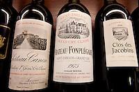 Fine wines Chateau Canon, Chateau Fonplegade, Clos des Jacobins in wine merchants shop in St Emilion, Bordeaux, France