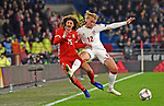 Cardiff - Wales - UK - 16th November 2018 - UEFA Nations League 2019 :<br />Wales v Denmark at the Cardiff City Stadium :<br />Ethan Ampadu of Wales is bungled into touch in the second half by Kasper Dolberg of Denmark.