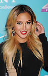 LOS ANGELES, CA - NOVEMBER 05: Adrienne Bailon  arrives at FOX's 'The X Factor' finalists party at The Bazaar at the SLS Hotel Beverly Hills on November 5, 2012 in Los Angeles, California.