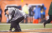 A stadium worker picks up a can of beer from the end zone that was thrown onto the field in the second half between the Cincinnati Bengals and the Pittsburgh Steelers during the Wild Card playoff game at Paul Brown Stadium on January 9, 2016 in Cincinnati, Ohio. (Photo by Jared Wickerham/DKPittsburghSports)