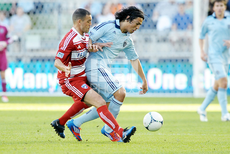Roger Espinoza.(15) Sporting KC midfielder watched by Daniel Hernandez... Sporting KC defeated FC Dallas 2-1 at LIVESTRONG Sporting Park, Kansas City, Kansas.