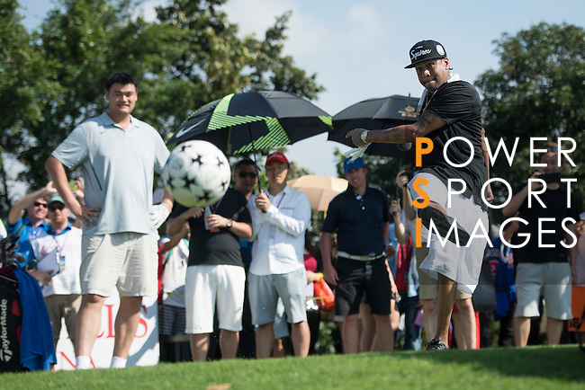 Allen Iverson kicks a football at the 14th hole during the World Celebrity Pro-Am 2016 Mission Hills China Golf Tournament on 22 October 2016, in Haikou, China. Photo by Weixiang Lim / Power Sport Images