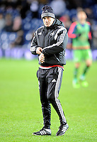 Manager Francesco Guidolin of Swansea City watches his players during the warm up before the Barclays Premier League match between West Bromwich Albion and Swansea City at The Hawthorns on the 2nd of February 2016