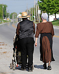 "A couple walk with their baby in Pennsylvania Dutch Country Amish Country in Lancaster County PA, Amish, Pennsylvania Dutch in Amish Country Lancaster County Pennsylvania, Amish, Horse and buggy with amish family on backroads of Pennsylvainia, buggy, amish family, buggy and horse, Commonwealth of Pennsylvania, Commonwealth of Pennsylvania, natives, Northeasterners, Middle Atlantic region, Philadelphia, Keystone State, 1802, Thirteen Colonies, Declaration of Independence, State of Independence, Liberty, Conestoga wagons, Quaker Province, Founding Fathers, 1774, Constitution written, Photography history, Fine art by Ron Bennett Photography.com, Stock Photography, Fine art Photography and Stock Photography by Ronald T. Bennett Photography ©, All rights reserved copyright Ron Bennett Photography.Com, FINE ART and STOCK PHOTOGRAPHY FOR SALE, CLICK ON  ""ADD TO CART"" FOR PRICING,"