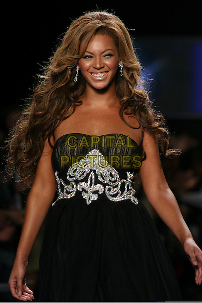 BEYONCE KNOWLES.Modelling at  Fashion For Relief Show at Olympus Fashion Week held at Bryant Park,.New York City, 16th September 2005.half length black strapless chiffon dress catwalk model .Ref: IW.www.capitalpictures.com.sales@capitalpictures.com.©Capital Pictures