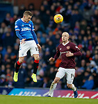 01.12.2019 Rangers v Hearts: Steven Davis towers over Steven Naismith to win the ball