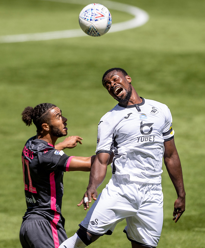 Leeds United's Tyler Roberts competing with Swansea City's Marc Guehi (right) <br /> <br /> Photographer Andrew Kearns/CameraSport<br /> <br /> The EFL Sky Bet Championship - Swansea City v Leeds United - Sunday 12th July 2020 - Liberty Stadium - Swansea<br /> <br /> World Copyright © 2020 CameraSport. All rights reserved. 43 Linden Ave. Countesthorpe. Leicester. England. LE8 5PG - Tel: +44 (0) 116 277 4147 - admin@camerasport.com - www.camerasport.com