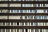 Budapest, Hungary. Residential appartments with a woman leaning out of one window.