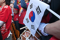 A South Korea supporter holds a nation flag at Soccer City in Johannesburg, South Africa on Thursday, June 17, 2010 during Argentina's and South Korea FIFA World Cup first round match.