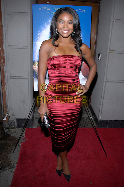 "GABRIELLE UNION.The stars come out to party and celebrate ""The Perfect Holiday""  at Marquee, New York, New York, USA,.10 December 2007..full length red strapless dress hand on hip.CAP/ADM/BL.©Bill Lyons/AdMedia/Capital Pictures. *** Local Caption ***"
