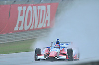 James Jakes, of Britain, shoots a rooster tail of rain during an IZOD Indycar Series practice session Friday afternoon at Barber Motorsports Park in Birmingham, Alabama.