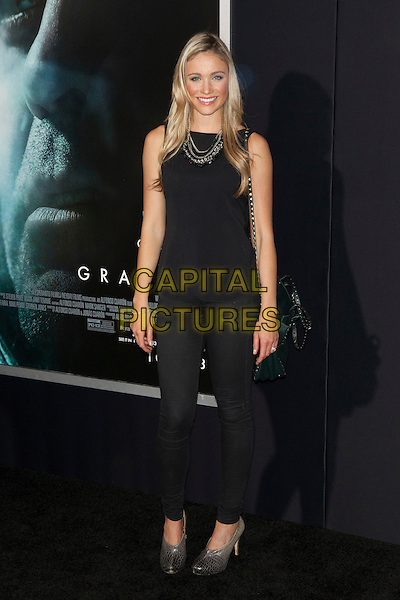 Katrina Bowden<br /> The 'Gravity' premiere at AMC Lincoln Square Theater, New York City, NY., USA.<br /> October 1st, 2013<br /> full length sleeveless black  top jeans denim <br /> CAP/MPI/COR<br /> &copy;Corredor99/ MediaPunch/Capital Pictures