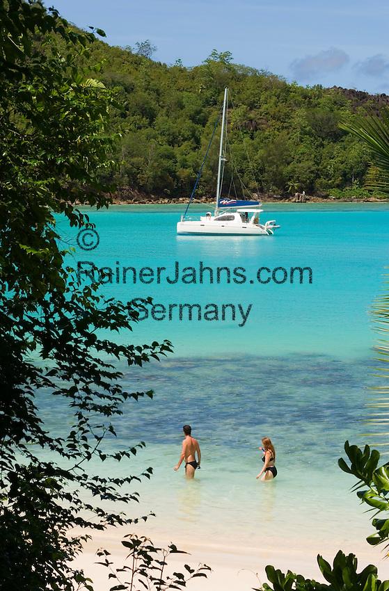 Seychelles, Island Mahe, Port Launay, Anse Souillac: sailing boat at Port Launay Marine National Park - couple