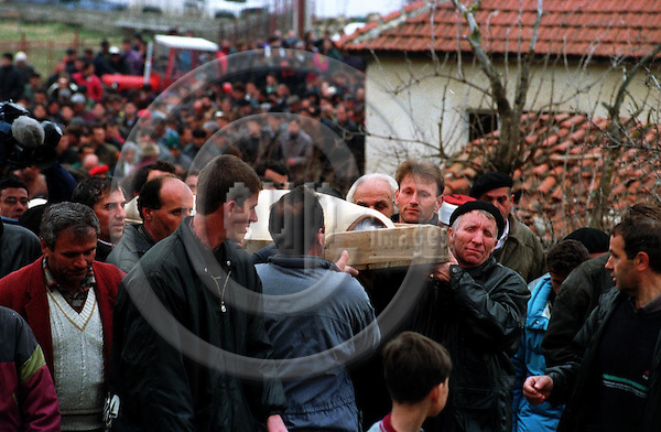 Funeral of eighteen year old ethnic Albanian Hazbi Veliu who was killed by a mortershell in the afternoon 15.3.99. The funeral was marked by the absense of women and children in nothern Kosovo town Bradash 35 kilometers north of the provincial capital Pristina..Kosovo, Yugoslavia, 16.3.99. Photo: CHRISTIAN JOERGENSEN / EUP-IMAGES