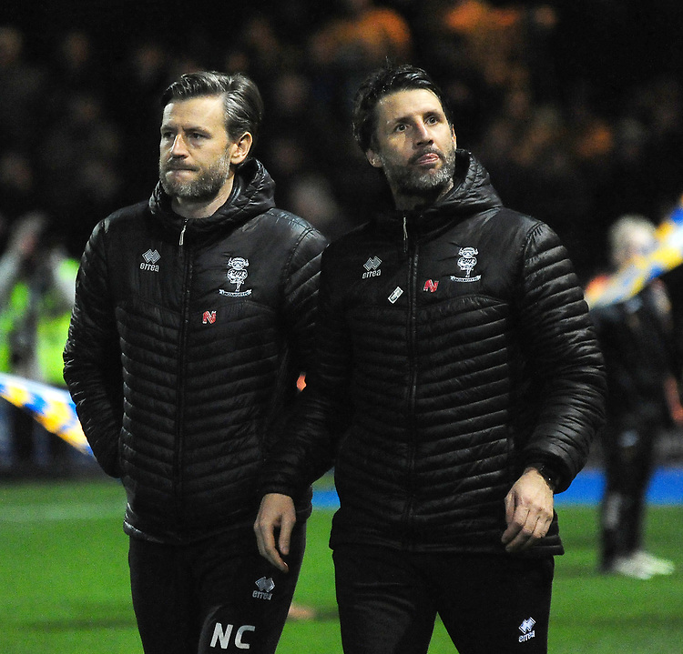 Lincoln City's assistant manager Nicky Cowley, left, and Lincoln City manager Danny Cowley before kick off<br /> <br /> Photographer Andrew Vaughan/CameraSport<br /> <br /> The EFL Sky Bet League Two - Mansfield Town v Lincoln City - Monday 18th March 2019 - Field Mill - Mansfield<br /> <br /> World Copyright © 2019 CameraSport. All rights reserved. 43 Linden Ave. Countesthorpe. Leicester. England. LE8 5PG - Tel: +44 (0) 116 277 4147 - admin@camerasport.com - www.camerasport.com