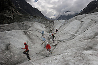 "Mer de Glace, the ""Sea of Ice"" has melted over the past 100 years so that ladders must be climbed to reach the foot of the glacier.  Climbers practice walking up inclines in crampons.  Mountain guides lead many groups over the ice to experience the glacier."