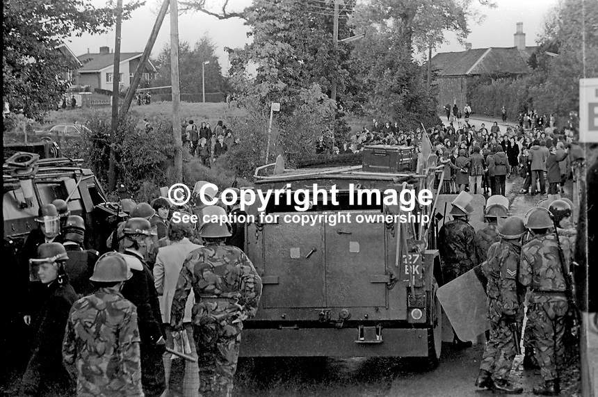 Soldiers and police confront Roman Catholics in the Suffolk area of West Belfast, N Ireland, who it is alleged were trying to take over nearby public housing occupied by Protestants. 9th July 1972, 197207090379b<br />