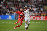 Cardiff City Stadium, Cardiff, South Wales - Tuesday 12th Aug 2014 - UEFA Super Cup Final - Real Madrid v Sevilla - <br /> <br /> Sevilla&rsquo;s Aleix Vidal parreu and Real Madrid&rsquo;s F&aring;bio Coentr&aring;o battle for the ball. <br /> <br /> <br /> <br /> <br /> Photo by Jeff Thomas/Jeff Thomas Photography