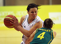 Tall Ferns guard Zoe Kensington looks to get the ball past Natalie Hurst during the International women's basketball match between NZ Tall Ferns and Australian Opals at Te Rauparaha Stadium, Porirua, Wellington, New Zealand on Monday 31 August 2009. Photo: Dave Lintott / lintottphoto.co.nz
